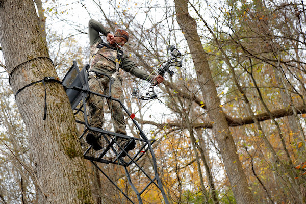 Bowhunter at full draw in the best ladder stand