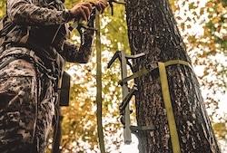 Hunter Attaching Climbing Sticks