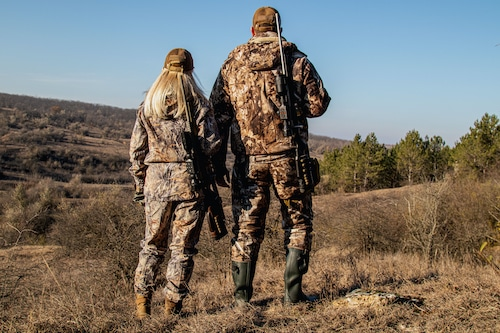 Man and woman hunting