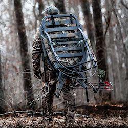 Summit Titan Climbing Tree Stand on Hunter's Back