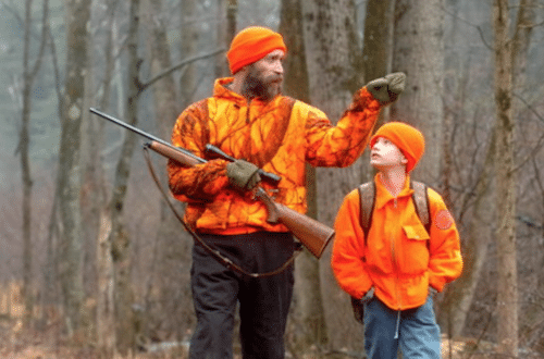 Father teaching son to hunt