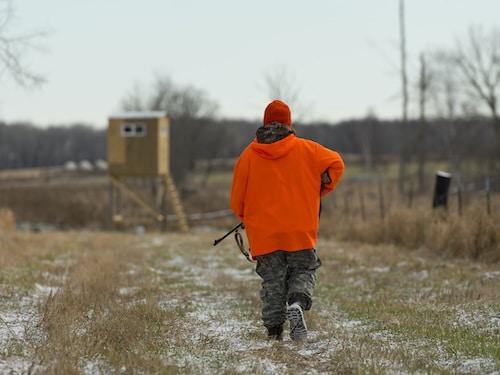 boy hunting deer